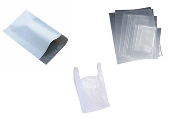 An Open White Poly Mailer, A Stack Of Transparent LDPE Plastic Bags, And A Biodegradable Plastic Bag