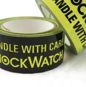 Two Bright Yellow And Black Alert Tape Rolls With Texts To Handle The Object Carefully