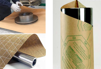 Rolls of VCI Paper (Uniwrap Woven) and VCI Paper (Uniwrap) and hands of man covering metal equipment with a VCI Paper