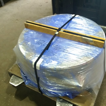 A large metal container covered by transparent VCI Stretch Film (polyethylene-like film)
